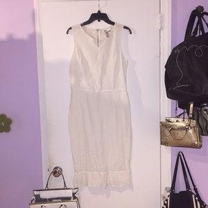 White cotton lace midi dress with ruffle hem
